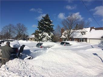 New York National Guard Airmen conducting snow clearance and debris removal missions in the towns of Townline and Hamburg, N.Y. on Nov. 21, 2014. (U.S.Army National Guard photo by Capt Shaun Joyce/ Released).