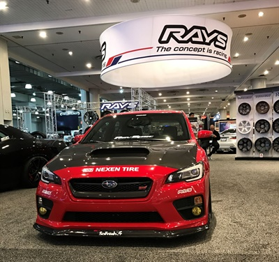 Three Nexen brand tires are fitted on the cars and on display in the Rays wheel brand booth at the New York International Auto Show.