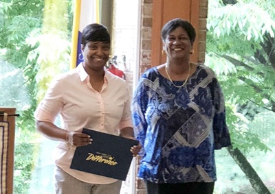 "Vicky Jarvis (left) received the ""Driver of the Year"" award from Keyana Wright, the president of the New York Association for Pupil Transportation's Nassau chapter."