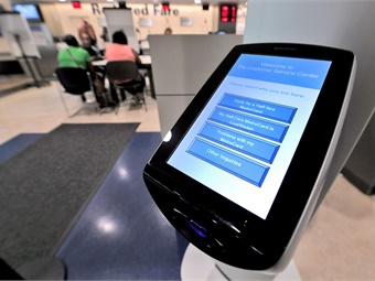 Now instead of standing in line, NYCT customers can use the Qmatic touchpad to self-select the reason for their visit.