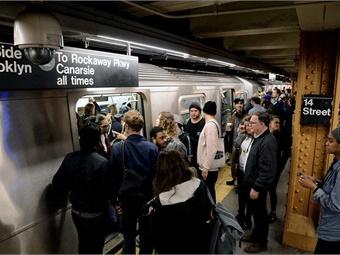 New York City Transit Subway commuters boarding trains. Marc A. Hermann/MTA New York City Transit