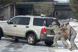 When a snowstorm froze up traffic in the Atlanta area, the National Guard came to the aid of stranded vehicles, including some 95 school buses. Photo by Sgt. 1st Class Frederick Gilyard, Georgia Army National Guard
