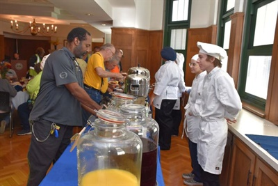 To kick off National School Bus Safety Week, Lyons Township High School chef's class students catered a special meal for bus drivers from First Student's La Grange, Ill., location during a bus driver appreciation and safety breakfast on Oct. 9. Photo courtesy Lyons Township High School