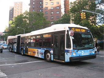 An M15 SBS bus passes Madison and James Streets, bound for South Ferry. Wikimedia Commons photo by Fan Railer.