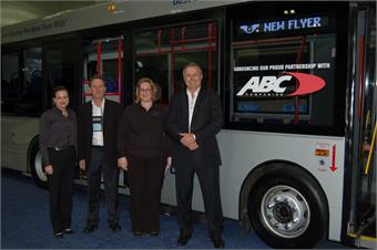 New Flyer and ABC officials, including New Flyer's Paul Smith, executive VP, sales and marketing, unvile the MiDi bus complete with new ABC logo.