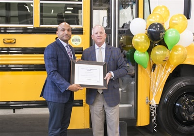 Tucker Perkins (left), the president and CEO of the Propane Education and Research Council (PERC), presented Shay Coates, the transportation director for Newport News Public Schools, with PERC's Clean Energy Innovation Award. Photo courtesy Blue Bird