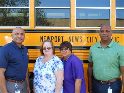 Newport News (Va.) Public Schools has acquired 24 Blue Bird Vision Propane school buses. Shown here from left to right are Shay Coates, director of transportation; Nancy Tarr, bus driver; Marion Walker, bus assistant; and James Riddick, operations supervisor.
