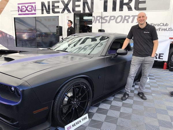 The 2018 Dodge Challenger R/T 392 Scat Pack awarded to Marine Cpl. Steven Diaz was displayed at the 2018 Specialty Equipment Market Assocation (SEMA) Show. Kyle Roberts, senior director of marketing for Nexen Tire America, is pictured.