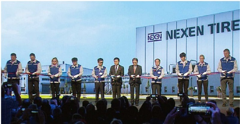Byung Joong Kang, the chairman of Nexen, Travis Kang, global CEO of Nexen Tire, Eung Young Lee, president of Nexen Tire Europe and Se In Oh, vice president of Nexen Tire Europe are joined by the technical staff and Europe Plant employees at the ribbon-cutting ceremony.