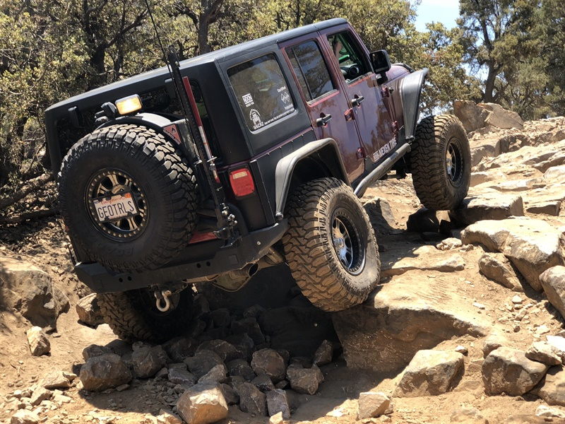 This Jeep, which is equipped with 37-inch Nexen Roadian MTX tires, climbs an obstacle on the Gold Mountain 4x4 trail in the San Bernardino Mountains.