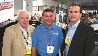 At the 2016 SEMA Show, analyst Nick Mitchell, right, and MTD analyst emeritus Saul Ludwig, left, met with Scott Jamieson, director of product management in North America for Cooper Tire & Rubber Co.