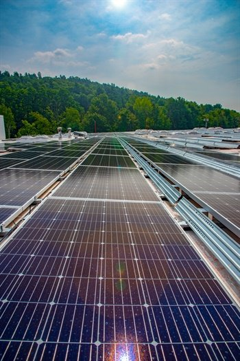 Solar panels atop a Nokian tire distribution center in Vermont are powering the facility, and also providing excess energy to the renewable power grid.