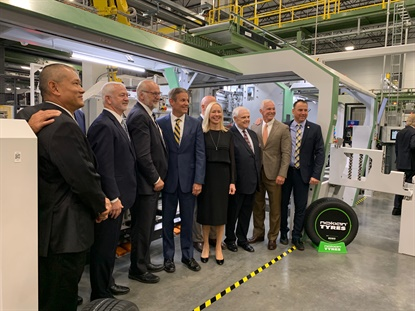 Nokian leaders and government officials posed for a photo in the tire building station of Nokian's tire plant in Dayton, Tenn.