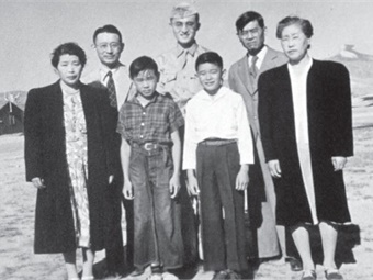 Norman Mineta (white shirt, front) and his parents Kunisaku and Kane (right) were forced by the government to live in the Heart Mountain, Wyoming internment camp during World War II. Photo courtesy of NHK/Norman Mineta