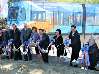 Following the signing of a FTA's Full Funding Grant Agreement, transportation officials joined with leaders from Santa Ana and Garden Grove — the two cities that originally developed the project — and with business and community leaders to break ground on the OC Streetcar.