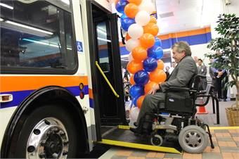 OCTA Vice Chair Greg Winterbottom boards the bus inside the agency's new facility. Photo courtesy OCTA.