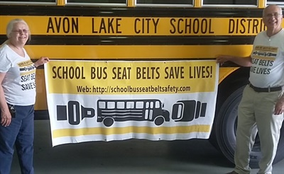 Avon Lake City Schools and Beachwood City Schools received 72-passenger Blue Bird school buses equipped with lap-shoulder belts to use in a pilot program. Shown here are School Bus Safety Alliance members Holly Moore Kowalski and Rudolph Breglia. Photo courtesy Rudolph Breglia