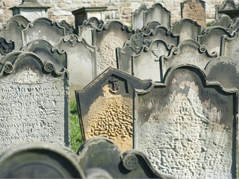 Photo of random old headstones via creepyhalloweenimages/Flickr