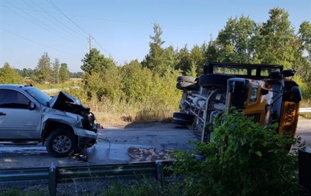 Police found that an Ontario school bus driver failed to stop at a stop sign before colliding with a pickup truck. Photo courtesy South Simcoe Police Service
