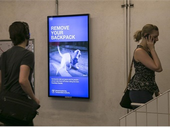 MBTA's new PSA campaign, which features GIF imagery, aims to promote rider etiquette and safety awareness in a new, engaging way. Photo: Outfront Media Inc.