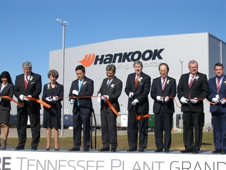 With the tire plant in the background, Hankook Tire Co. Vice Chairman and CEO Seung Hwa Suh leads a group of dignitaries at the ribbon-cutting ceremony. From left: Many-Bears Grinder, Tennessee commissioner of veterans affairs; Burns Phillips, Tennessee commissioner of labor;Kim McMillan, Clarksville mayor;Hyun Shick Cho, Hankook Tire Worldwide; Suh; Bob Rolfe, Tennessee commissioner of economic and community development; Seong-Jin Kim, Korean consul general; Curtis Johnson, Tennessee state representative; and Mark Green, Tennessee state senator.