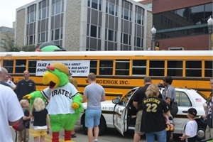 During a bus safety event prior to the Pittsburgh Pirates game on Sept. 1, volunteers provided tours of school buses and distributed toy school buses and activity booklets on safety.