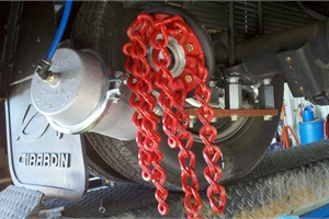 Onspot's chains allow the operator to engage and disengage tire chains at  the flip of a switch.