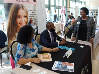 From left to right, Palm Tran DBE Grants Coordinator Claudia Salazar and Executive Director Clinton B. Forbes answer questions from vendors.