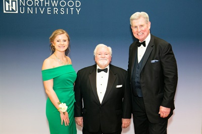 Northwood University has awarded its Outstanding Business Leader Award to Aftermarket Auto Parts Alliance CEO and President John Washbish (center). He is pictured with Morgen Panning (left), a Northwood student, and Keith Pretty, CEO and president of Northwood University.