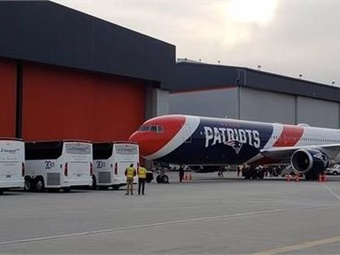 Champion Coach's MCI J4500s waiting at airport to transport New England Patriots to Super Bowl LIII in Atlanta. Photo: MCI