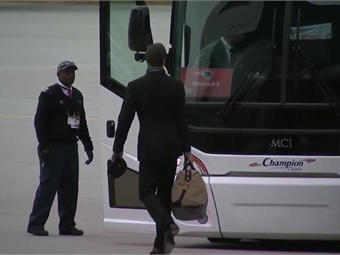 New England Patriots player ready to board coach. Photo: MCI
