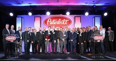 Representatives of Rush Peterbilt accept the TRP Bus Segment Dealer of the Year Award at the PACCAR Parts and Peterbilt Anaheim 2016 Parts And Service Meeting. Photo courtesy Tony Kawashima