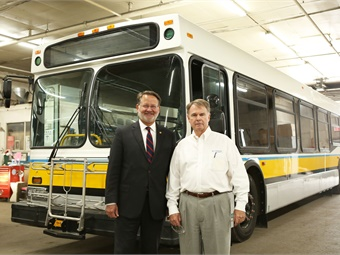Photo caption: Senator Gary Peters (left) joins Midwest Bus Corp. President/Founder Dan Morrill for a recent tour of the company's main facility in Owosso, Mich. Midwest Bus Corp.