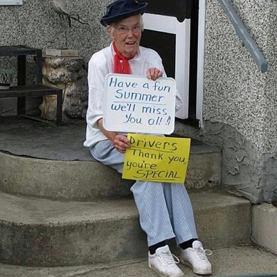 "For years, Margaret ""Phemie"" Hunka waved and held up signs for students riding buses by her home in Alberta. She passed away last year."