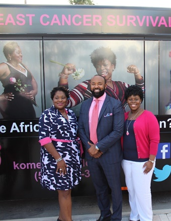 Karen Alleyne-Means (left) and Tanzanika Lillard (right) pose in front of their portraits alongside Palm Tran Executive Director Clinton B. Forbes. Photo: Palm Tran