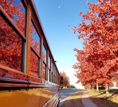 Jay Hamrick of Blue Springs, Mo., was one of the winners in the 2019 SBF Photo Contest with this image of bright red autumn leaves reflecting along the bus's windows before his early morning route.