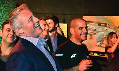 Matt LeBlanc has some fun at P Zero World owner Claus Ettensberger's expense. At the same time, LeBlanc's Top Gear co-host, Chris Harris, right, enjoys the give and take.