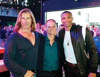 Although owned by Claus Ettensberger (pictured with model and actor Fabio on his right and NBA all-star Russell Westbrook), the three-bay retail store will double as Pirelli Tire North America's West Coast headquarters.