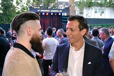 Pierluigi Dinelli, right, chairman and CEO of Pirelli North America Inc., talks with Adam Goldston, founder of Athletic Propulsion Labs, at the grand opening of Pirelli's P Zero World store in Los Angeles. The estimated growth of prestige car registrations in 2016 is 11%, while the total market is more or less flat, says Dinelli.