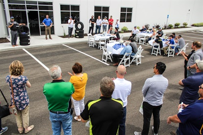 Walter Lybeck, CEO of Tire Factory dba Point S USA, spoke to the group's members and vendor representatives during a ceremony to celebrate the expansion of the Salt Lake City warehouse.