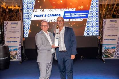 Bruno Leclair of Point S Canada, left, accepts the Excellence Award from Fabian Bouquet, CEO of Point S International.
