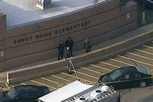 Police at Sandy Hook Elementary after the shooting on Dec. 14. Many districts across the nation have since reassessed security procedures and stepped up security personnel presence. Photo from Voice of America