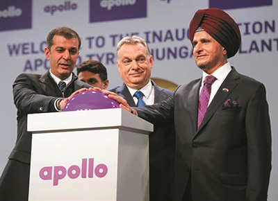 Vice Chairman and Managing Director Neeraj Kanwar (left), Hungary Prime Minister Viktor Orban and Chairman Onkar Kanwar celebrate the opening of the Apollo Tyres Ltd. plant in Budapest.