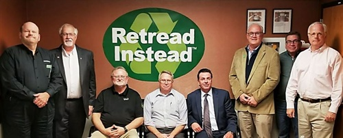 """Retread Instead brainstormed ideas to boost support for tariffs on Chinese TBR tires with industry leaders (left to right): Ron Elliott, marketing manager, Marangoni Tread and Retread Instead spokesperson; Bill """"Waz"""" Waerzeggers, director of manufacturing, Pomp's Tire Service; Tim BeVier, national account business development, Tech International; Jim Osborne, general manager, retread operations, McGriff Treading; Gene Walker, vice president, Premier Rubber; Bill Sweatman, president, Marangoni Tread; Shawn Wilkening, vice president, Cross Dillon Tire; and Hal Stuhl, vice president rubber products, Accella."""