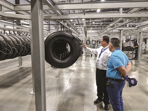 Larry Lafreniere, Houston sales manager for Beasley Tire Service, explains the retreading process to one of its customers at the grand opening celebration for the company's 36,000-square-foot retread plant.