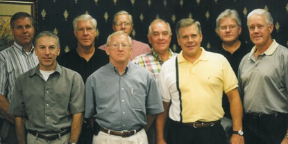 Raben Tire Co.'s senior management team in September 2002, when Tom Raben (second row, second from far left) was named MTD's 2002 Tire Dealer of the Year.