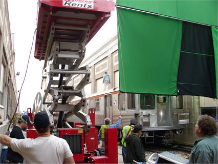 Filming a scene from the movie SAFE, using a green screen at SEPTA's Fern Rock car shop.