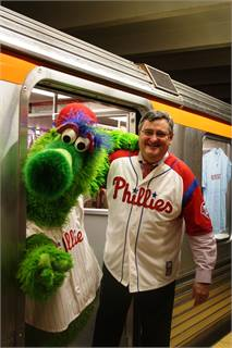 SEPTA GM Joe Casey and the Phanatic welcoming passengers on board the Broad Street Line subway.
