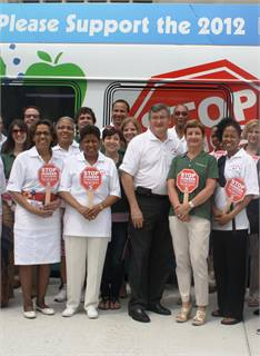 GM Joe Casey (center) kicked off SEPTA's 2012 food drive to benefit Philabundance. Since 2009, the agency has collected over 65 tons of food during the month-long drive. Casey is the driving force behind the event.