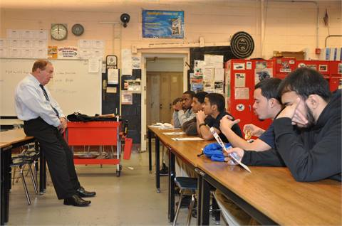 Jim Barnshaw, a former mechanic, electrician, foreman and rail shop director at SEPTA, speaks to students at Philadelphia's Mastbaum Vocational High School about jobs at the agency.